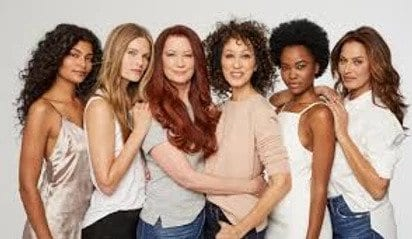Photo of women hugging and posing together