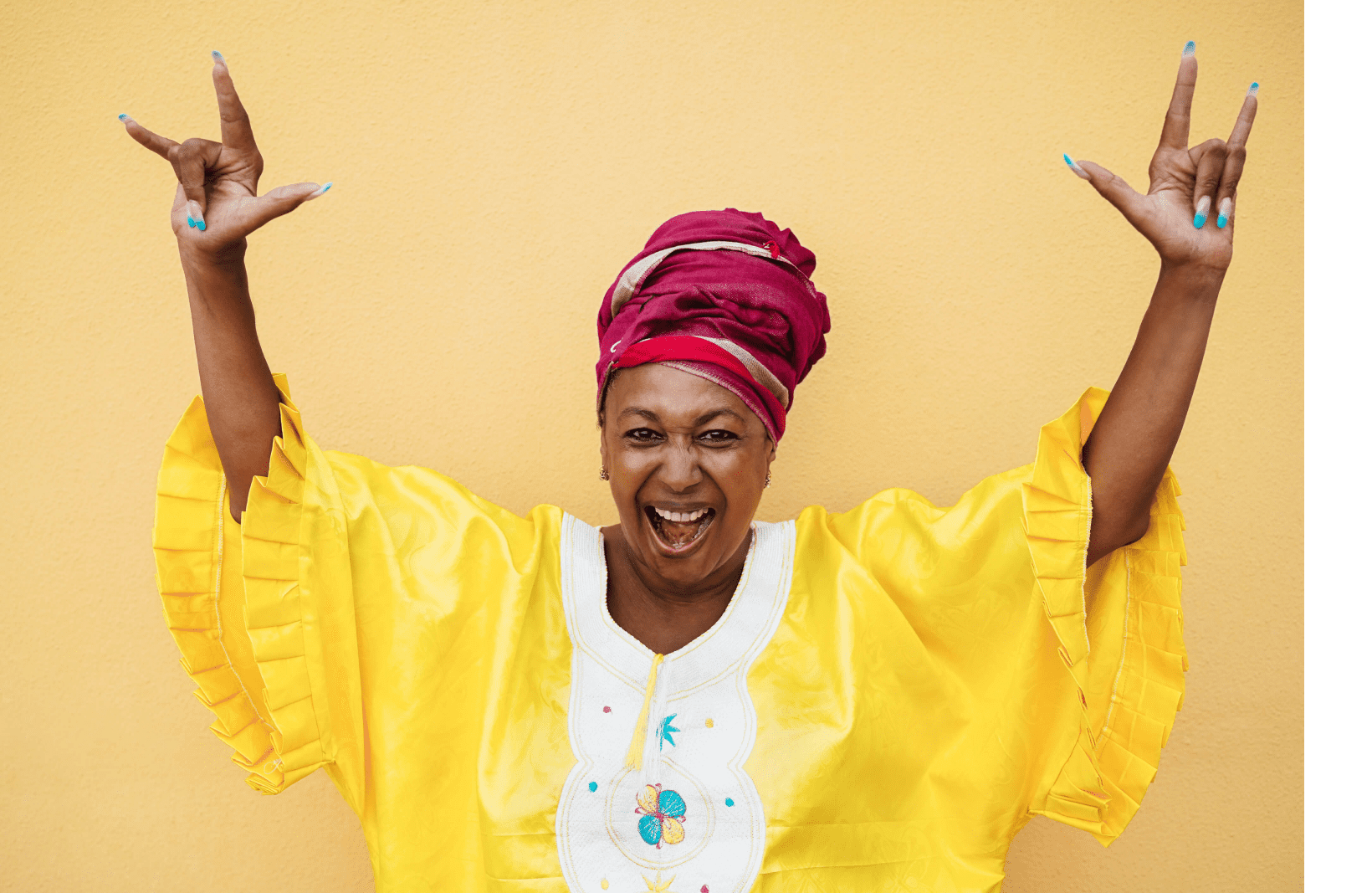 An image of a happy black woman in a yellow dress with her hands in the air