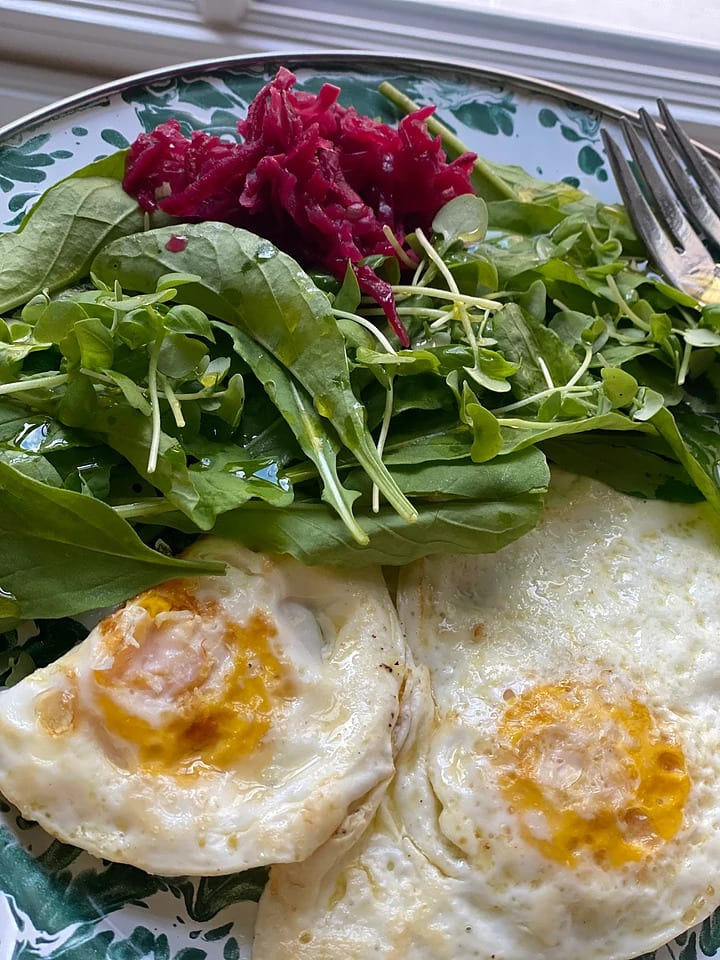 Eggs with greens on a plate