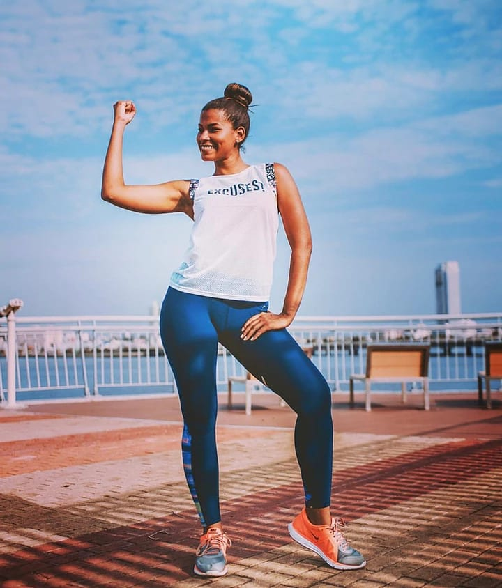 A fit woman flexing her bicep