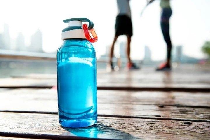A blue sports water bottle